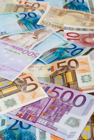 Background of euros with shallow depth of field: ten, twenty, fifty and five-hundred euro banknotes.