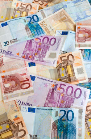 Background of euros: ten, twenty, fifty and five-hundred euro banknotes.