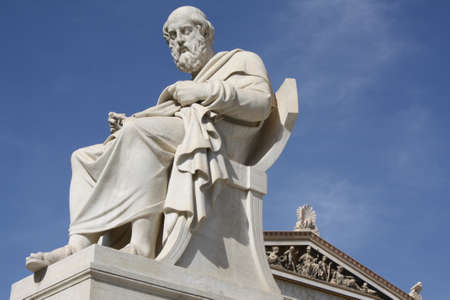 ancient philosophy: Neoclassical statue of ancient Greek philosopher, Plato, in front of the Academy of Athens in Greece. Stock Photo