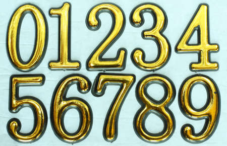 Golden bright numbers on a light blue background. Stock Photo - 8677345