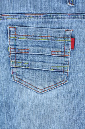 red pants: Blue jeans back pocket with colourful stitches. Stock Photo