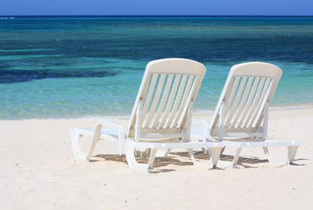 Two sun loungers facing the Caribbean Sea Stock Photo - 9359798