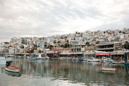 View of Mikrolimano Port in Piraeus, near Athens, Greece, at sunset. Stock Photo