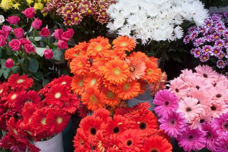 florists: Some bunches of different varieties of colourful flowers on display in a florist shop. Stock Photo