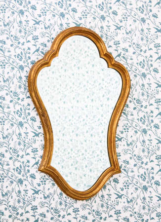 mirror on wall: Golden Mirror Frame on Wall with Victorian Wallpaper. Stock Photo