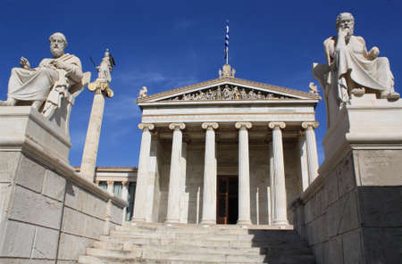 Neoclassical Academy of Athens in Greece showing main building and statues of ancient Greek philosophers Plato (left), Socrates (right) and goddess Pallas Athena (behind Plato). The Academy of Athens is the highest research establishment in the country an