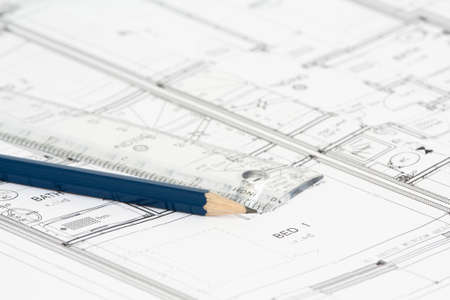 depth measurement: An architects new building plan with ruler and blue pencil. Stock Photo