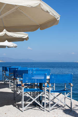 dodecanese: A restaurant by the Aegean sea in one of the Dodecanese islands, Greece. Stock Photo
