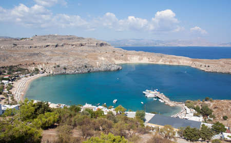 rhodes: View from above of the main beach in Lindos, Rhodes, one of the Dodecanese Islands in the Aegean Sea, Greece.