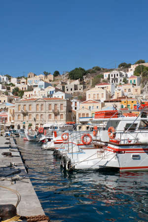 dodecanese: Gialos, the harbour of the island of Symi in the Dodecanese, southeast of Aegean Sea, Greece. Stock Photo