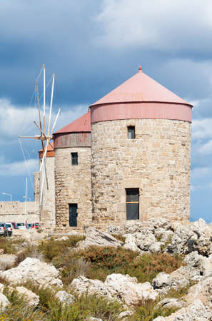 rhodes: Medieval windmills at Mandraki Harbour in the Dodecanese island of Rhodes, Greece.