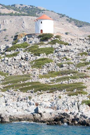 An old windmill in Symi, a Dodecanese island, Greece. photo