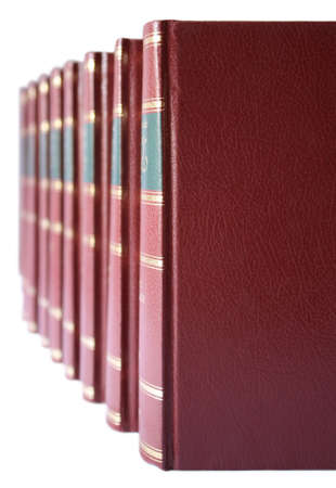 hard bound: A row of a collection of books with red leather hard cover on a white background.