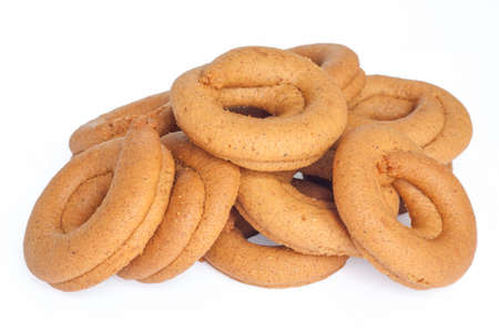 and grape juice: Pile of moustokouloura, Greek grape juice biscuits, on a white background