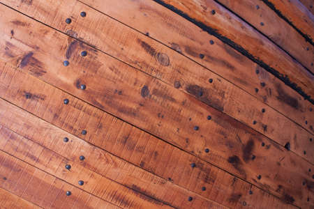 Wooden planks and nails from hull of an old ship  Stock Photo - 16033136