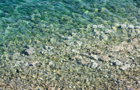 Abstract of shallow crystal clear blue water of Aegean Sea in a beach in Bodrum, Turkey Stock Photo - 16033134