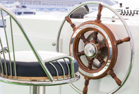 Closeup of rudder and chair in a luxury boat. photo