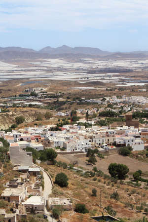 bird 's eye view: Bird s eye view of Nijar, a typical whitewashed Andalusian village in the province of Almeria, Spain, with greenhouses in the background  Stock Photo