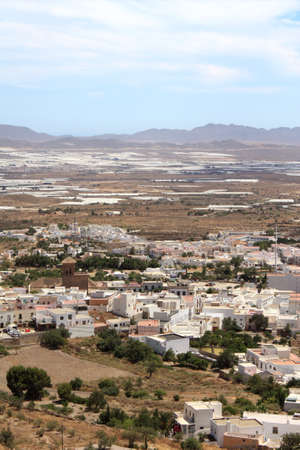 Bird s eye view of Nijar, a typical whitewashed Andalusian village in the province of Almeria, Spain, with greenhouses in the background Stock Photo - 18990514