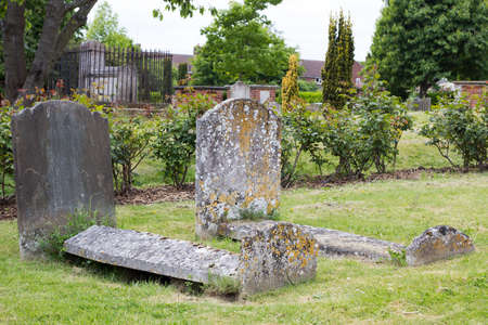 coffins: Two old and weathered stone coffins  in a churchyard in England.