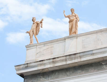 civilisation: Sculptures of Apollo and Hera on the roof-top above the entrance of the National Archaeological Museum of Athens in Greece
