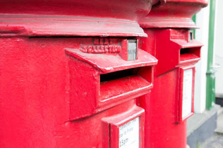 Closeup of two traditional British red mail boxes  photo