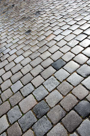 uneven: Old and wet cobblestoned street in Nuremberg, Germany
