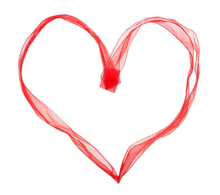 Red ribbon in the shape of heart on a white background