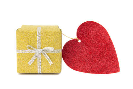 St Valentines golden shiny gift box and red heart shaped card on white background  photo