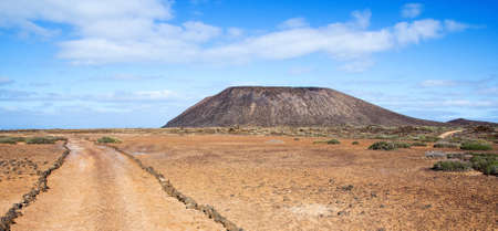 Trail and volcano La Caldera on the small island of Los Lobos, near Fuerteventura, in the Canary Islands, Spain  photo