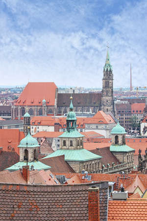 bayern old town: View over Nuremberg old town from the Kaiserburg, Franconia, Bavaria, Germany, with the spires of the Town Hall or Rathaus and St Lawrence church or Lorenzkirche  Editorial