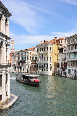 waterbus: View of the Grand Canal, Italian palaces and a waterbus from Ponte di Rialto or Rialto Bridge in Venice, Italy.