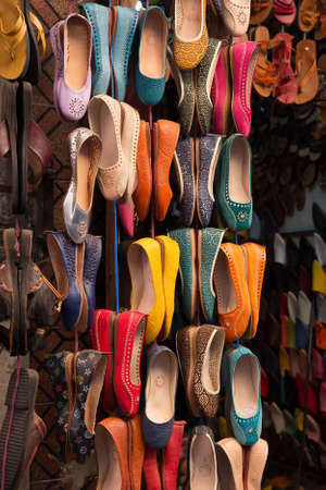 made in morocco: Colourful leather shoes on display in a bazaar in the Medina of Marrakech, Morocco.