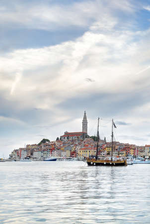 dominating: Late afternoon in the old Istrian town of Rovinj or Rovigno in the Adriatic Sea of Croatia with the Saint Euphemias Basilica dominating the town.
