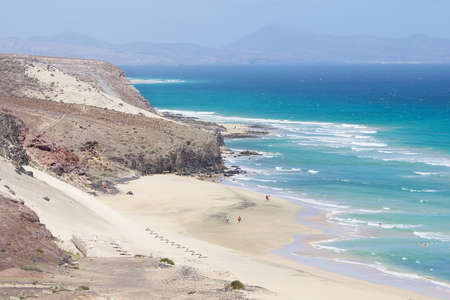 nombre: Mal Nombre beach or Playa del Mal Nombre on a windy day, with its golden sand, situated on the south east coast of the island of Fuerteventura, Canary Islands, Spain.