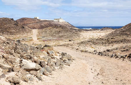 Faro de Punta Martino lighthouse on the island of Lobos or Wolves Island, situated two kilometres north of the island of Fuerteventura, Canary Islands, Spain.