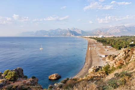 Konyaalti Beach at Antalya in Turkey with Bydaglari Mountains in the background.