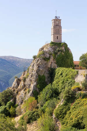 View of picturesque Arachova mountainous village with iconic tower clock in Greece, at the foot of Mount Parnassos, near Delphi.