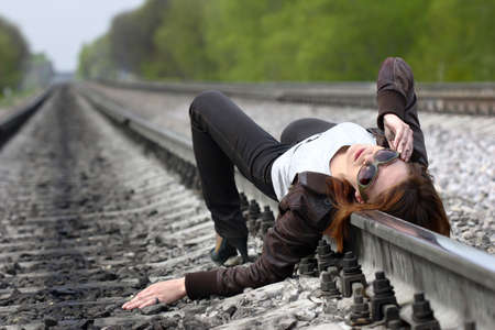 wood railroads: girl on the rail  Stock Photo