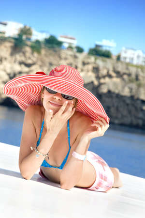 woman with red hat photo