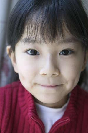 way of behaving: Young girl looking at camera smiling, Beijing , China