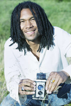 Portrait of a man smiling holding an old camera Stock Photo - 16043388