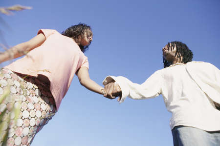 Low angle view of a young couple holding hands outdoors Stock Photo - 16043390