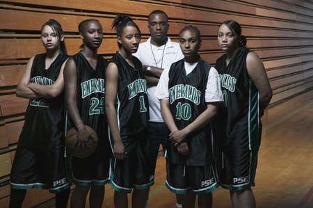 african solidarity: A team of female teenage basketball players on a basketball court LANG_EVOIMAGES