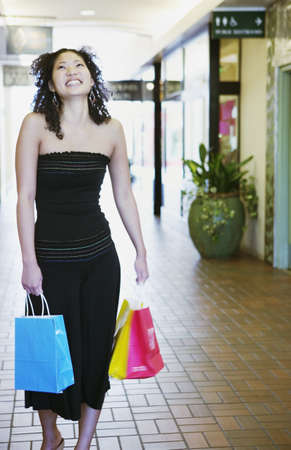ebullient: Young woman carrying shopping bags