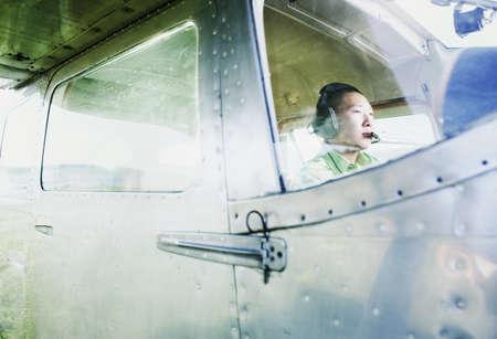 legroom: Male pilot in Cessna 110