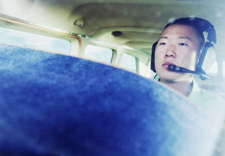 Male pilot in Cessna 110 wearing a headset Stock Photo - 16043490