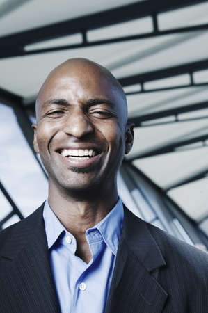 effrontery: Businessman standing on a walk bridge smiling