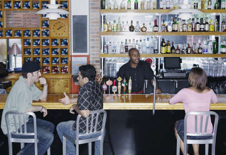 knees bent: People sitting at a bar