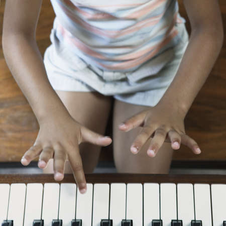 affective: Young girl playing the piano